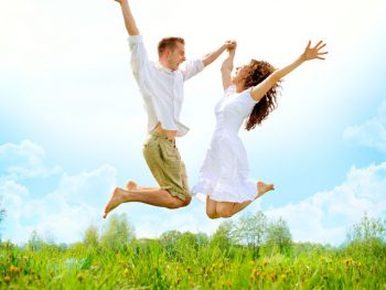 Happy couple leaping with joy